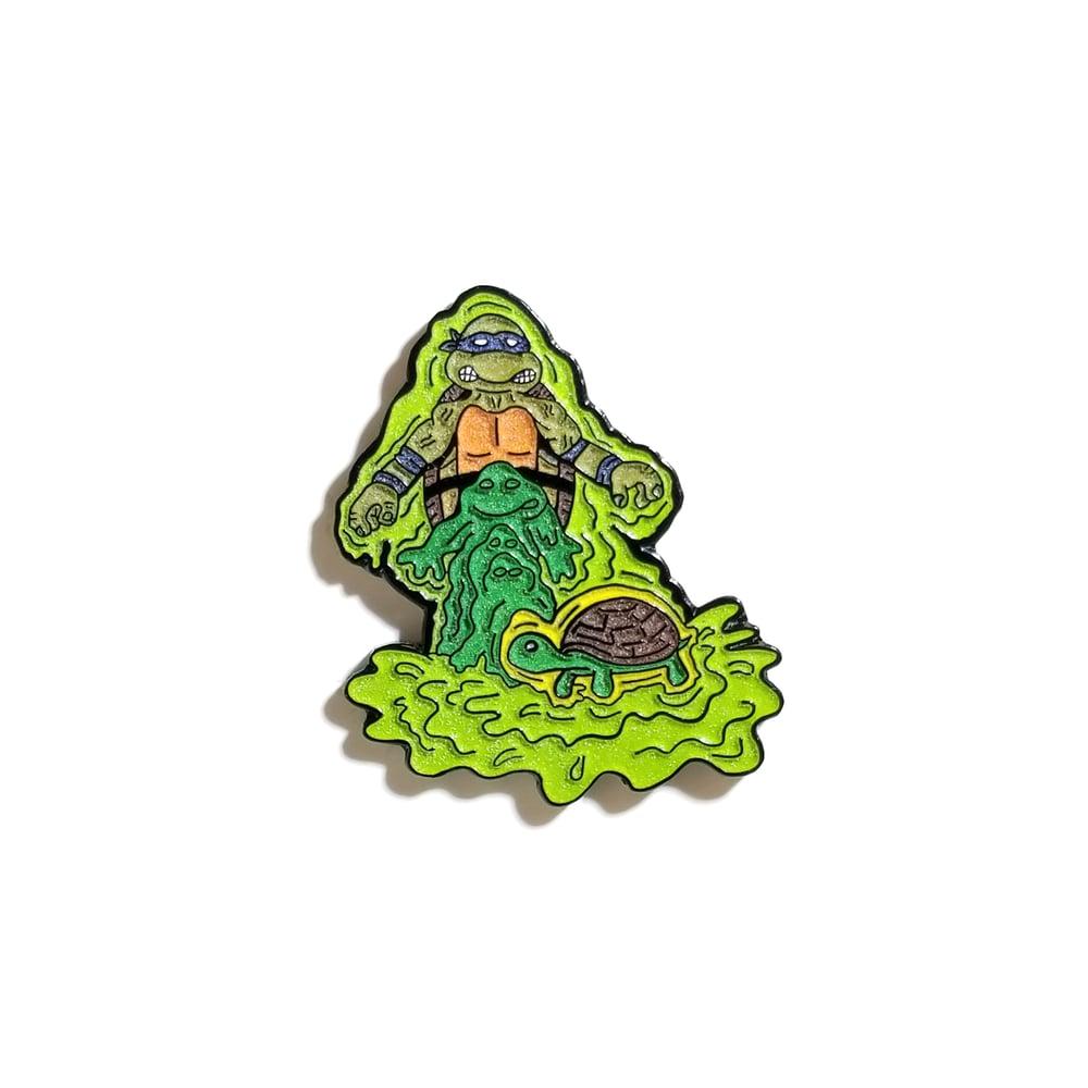 Image of Mutation Leo lapel pin