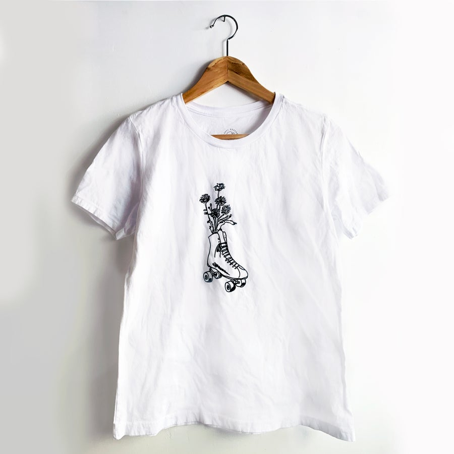 Image of ROLLER SKATE FLOWER WOMAN'S TEE / COLLAB WITH COAST MODERN - WHITE