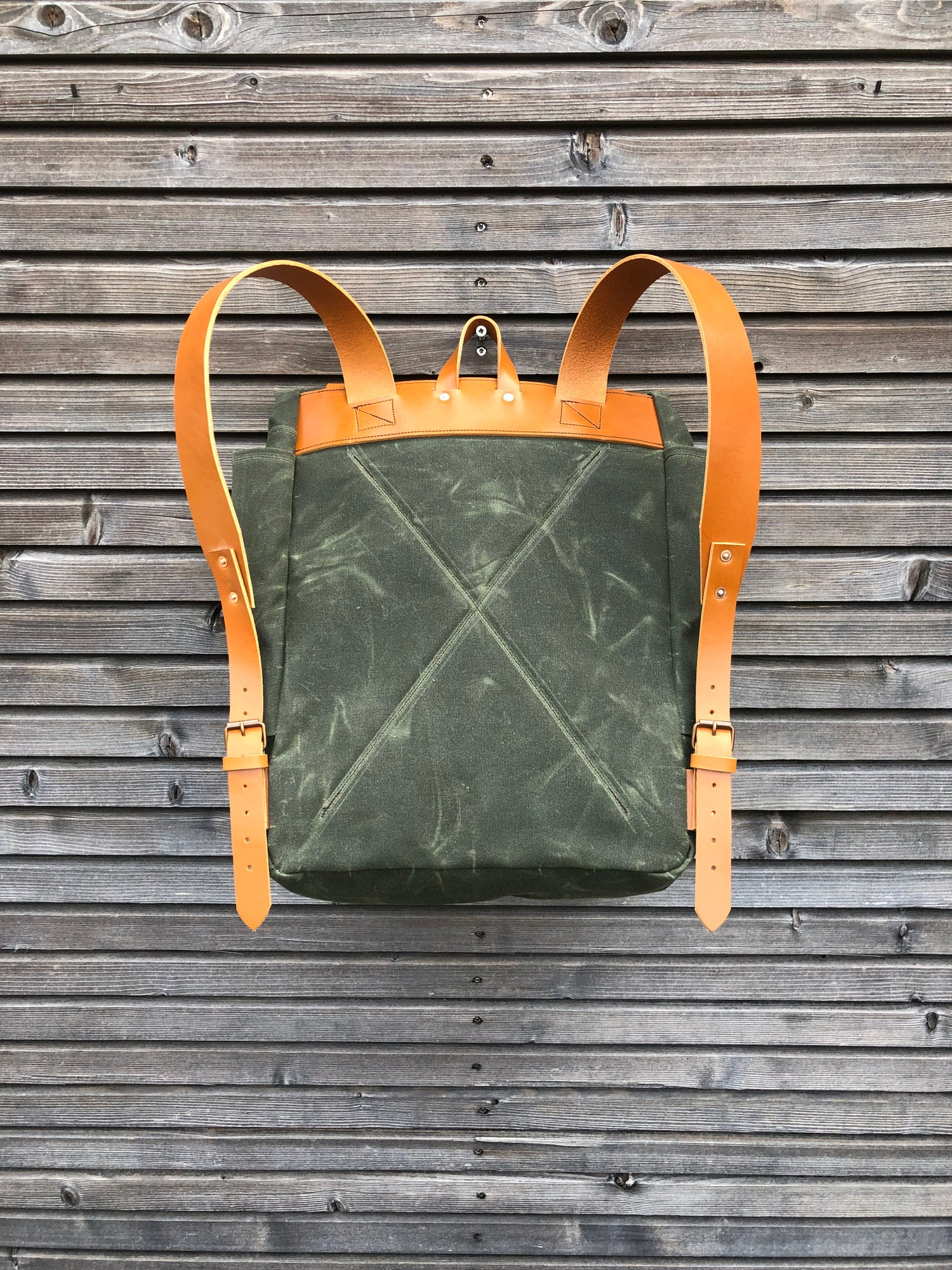 Image of Waxed canvas backpack with roll to close top and vegetable tanned leather shoulderstrap
