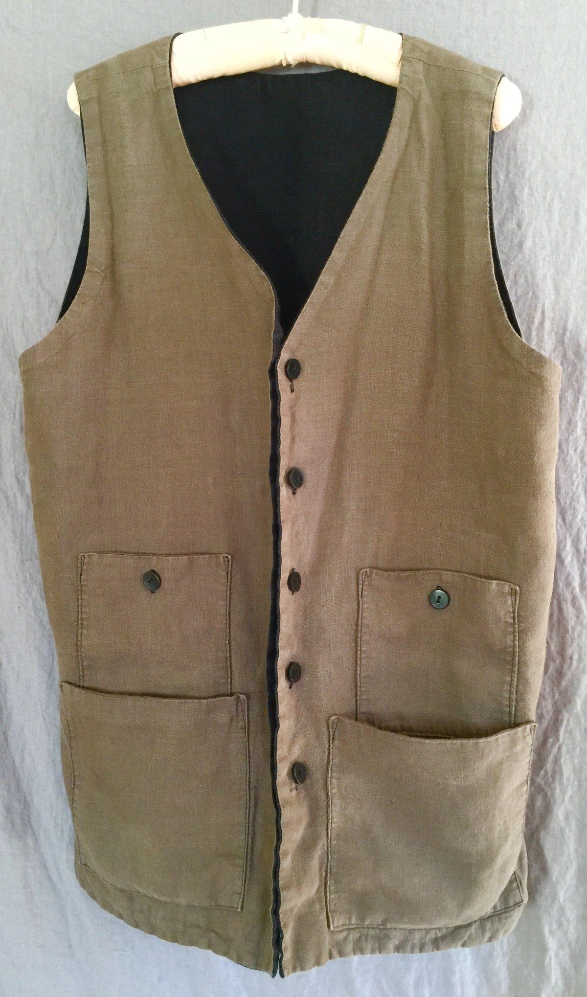 Image of reversable pocket vest