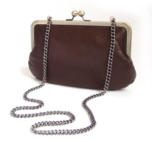 Image of Brown leather clutch bag with chain handle