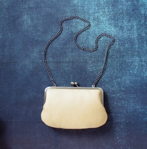 Image of Yellow leather clutch bag with chain handle