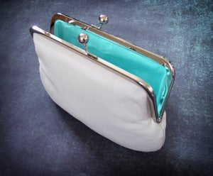 Image of White leather clutch bag with chain handle