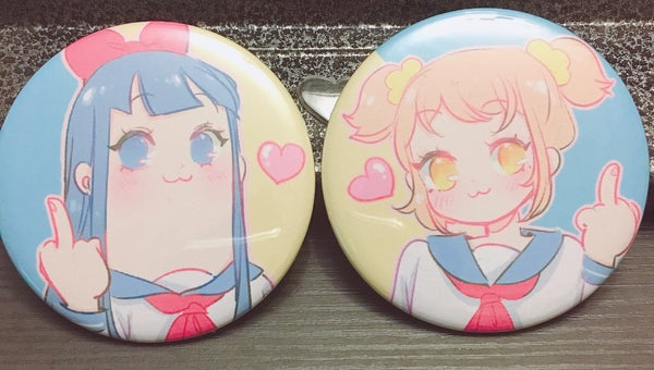 "Image of Popteam 2.25"" button pair"