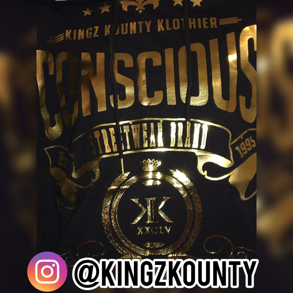 "Image of GOLD ""CONSCIOUS"" KINGZ KOUNTY LOGO SHORT SLEEVE HOODIE"