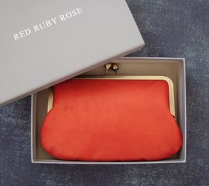 Image of Burnt orange leather clutch bag with chain handle