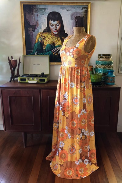 Image of Empire waist maxi dress in Pushing daisies Orange and brown print