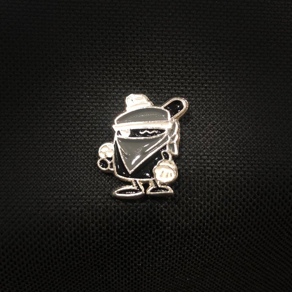 Image of VANDAL CLOGGED CAP PIN