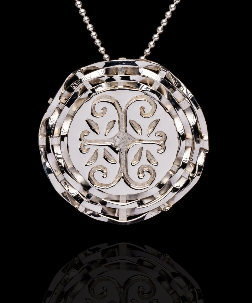 Image of Wolastokiyik skicinuwihq,  people or the beautiful river, basket weave pendant