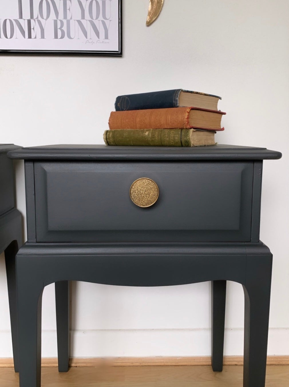 Image of A pair of dark grey stag bedside tables