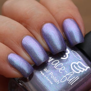 Image of Supercalifrag An ethereal mauve linear holo with aurora shimmer in blue-purple and teal-blue