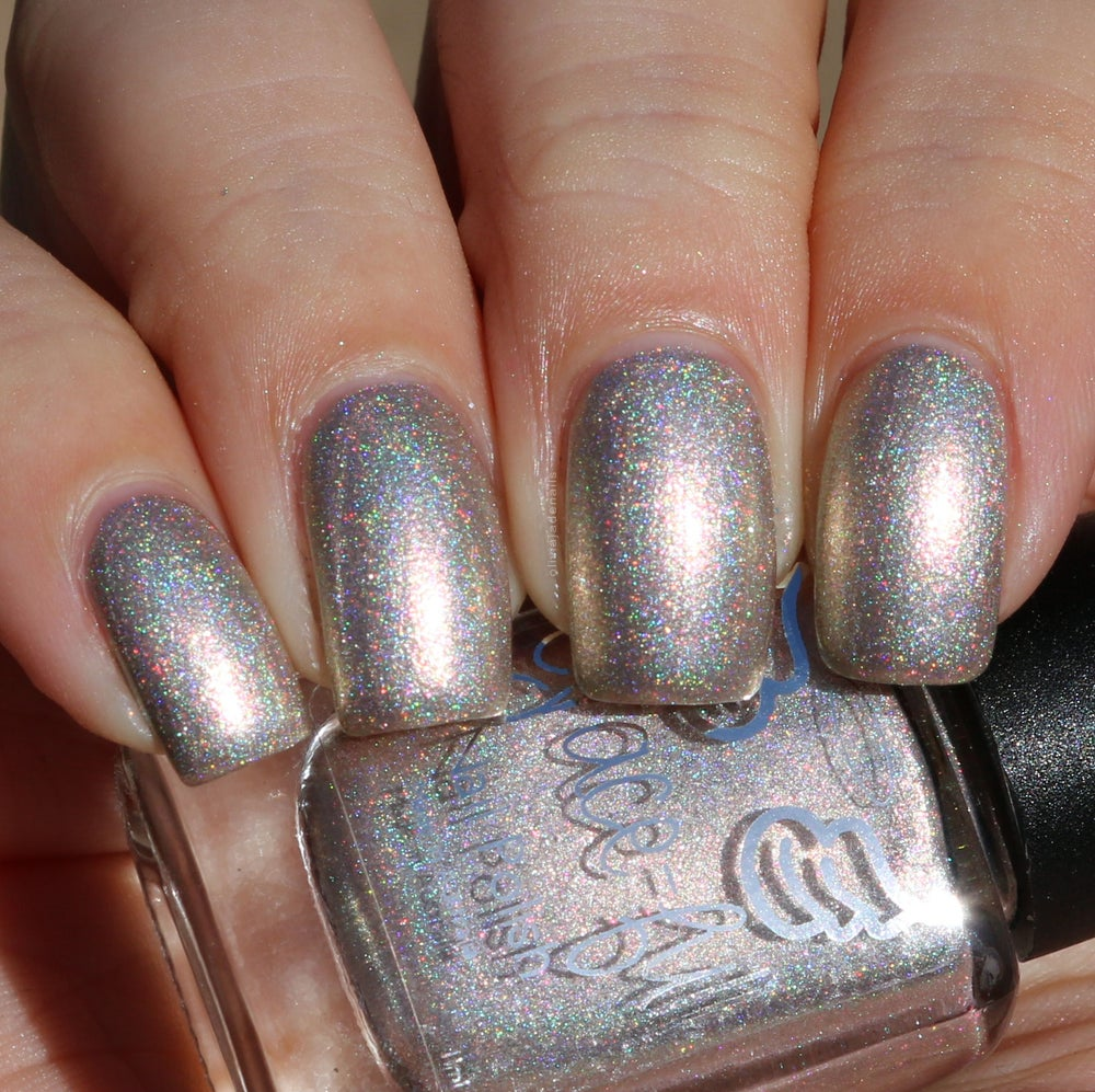 Image of Sister Suffragette A neutral/gold linear holo packed with red and gold aurora shimmer