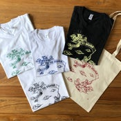 Image of Islands vs Islands shirts and tote bag