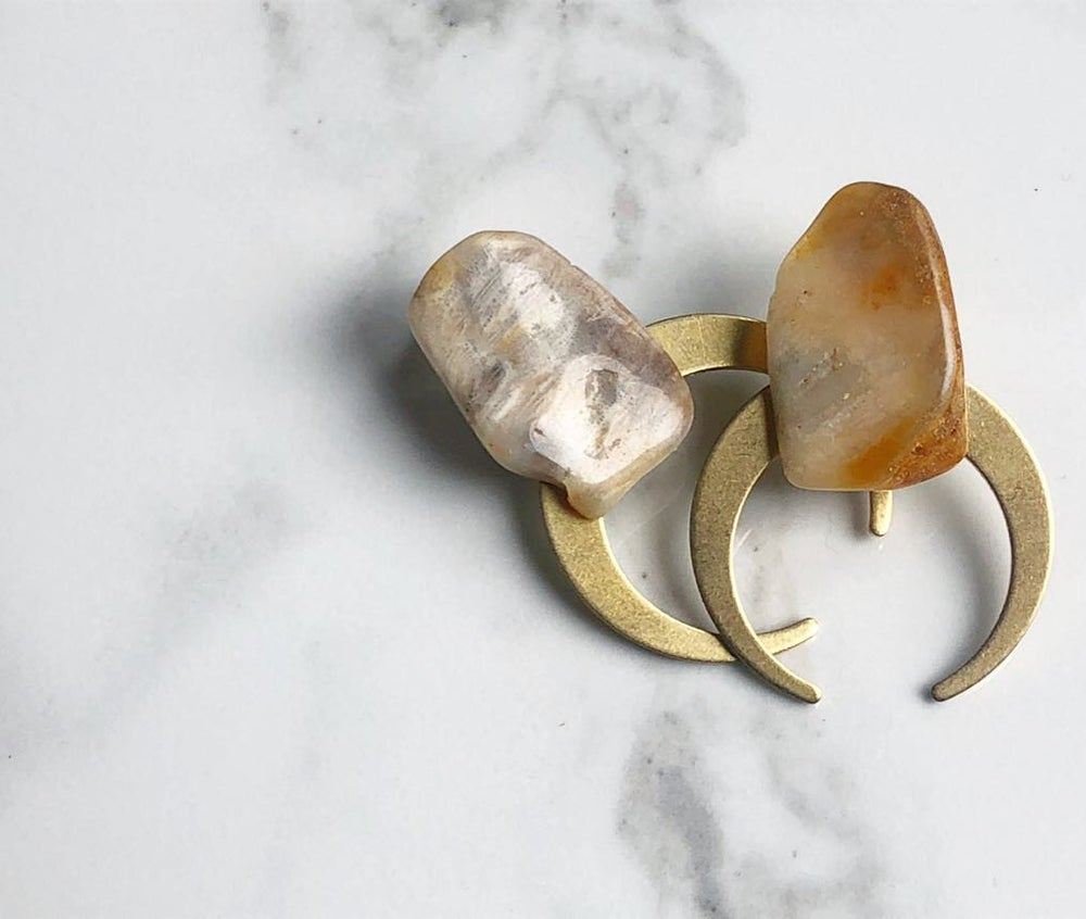 Image of thin brass moons + stone