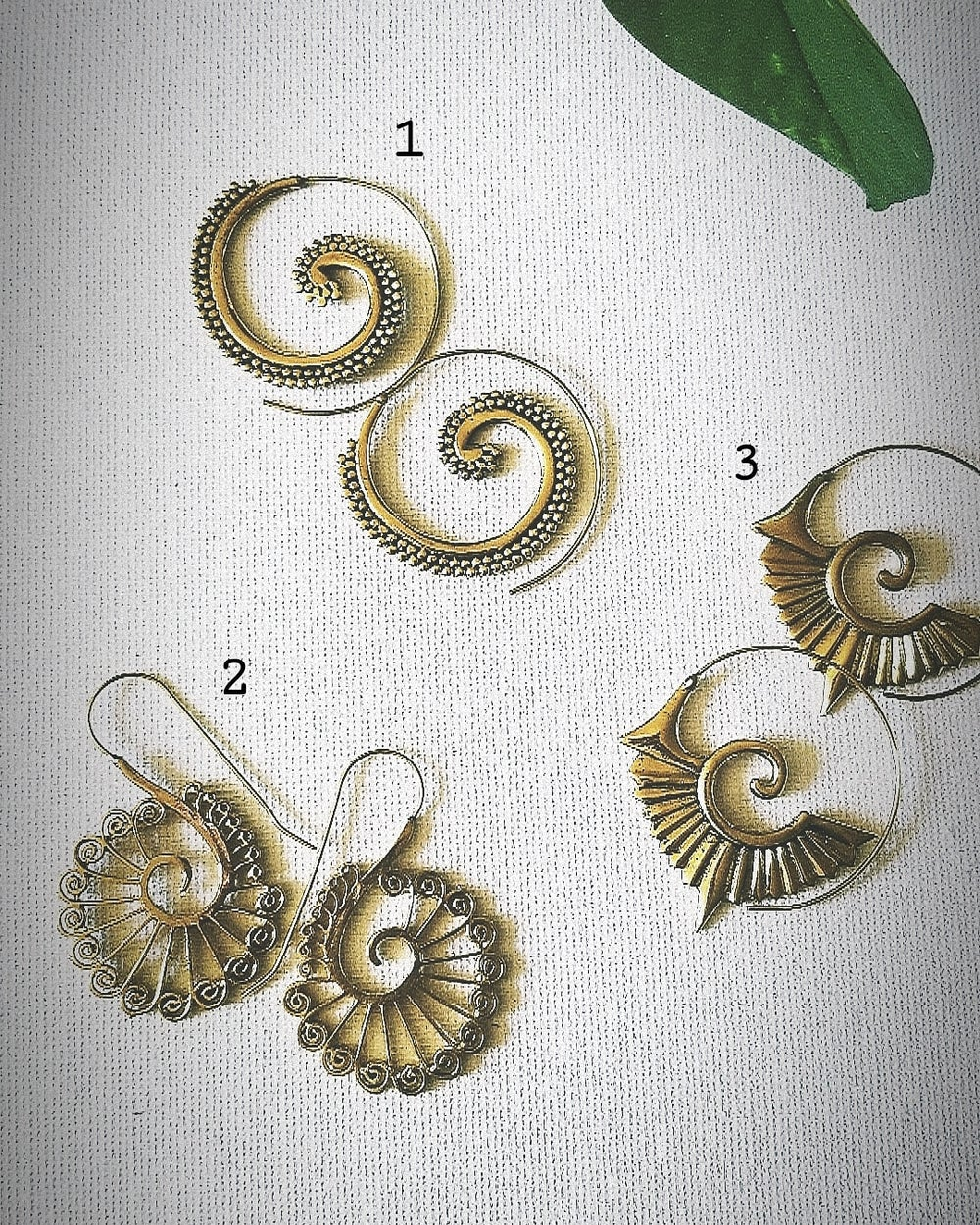 Image of • Brass swirl earrings