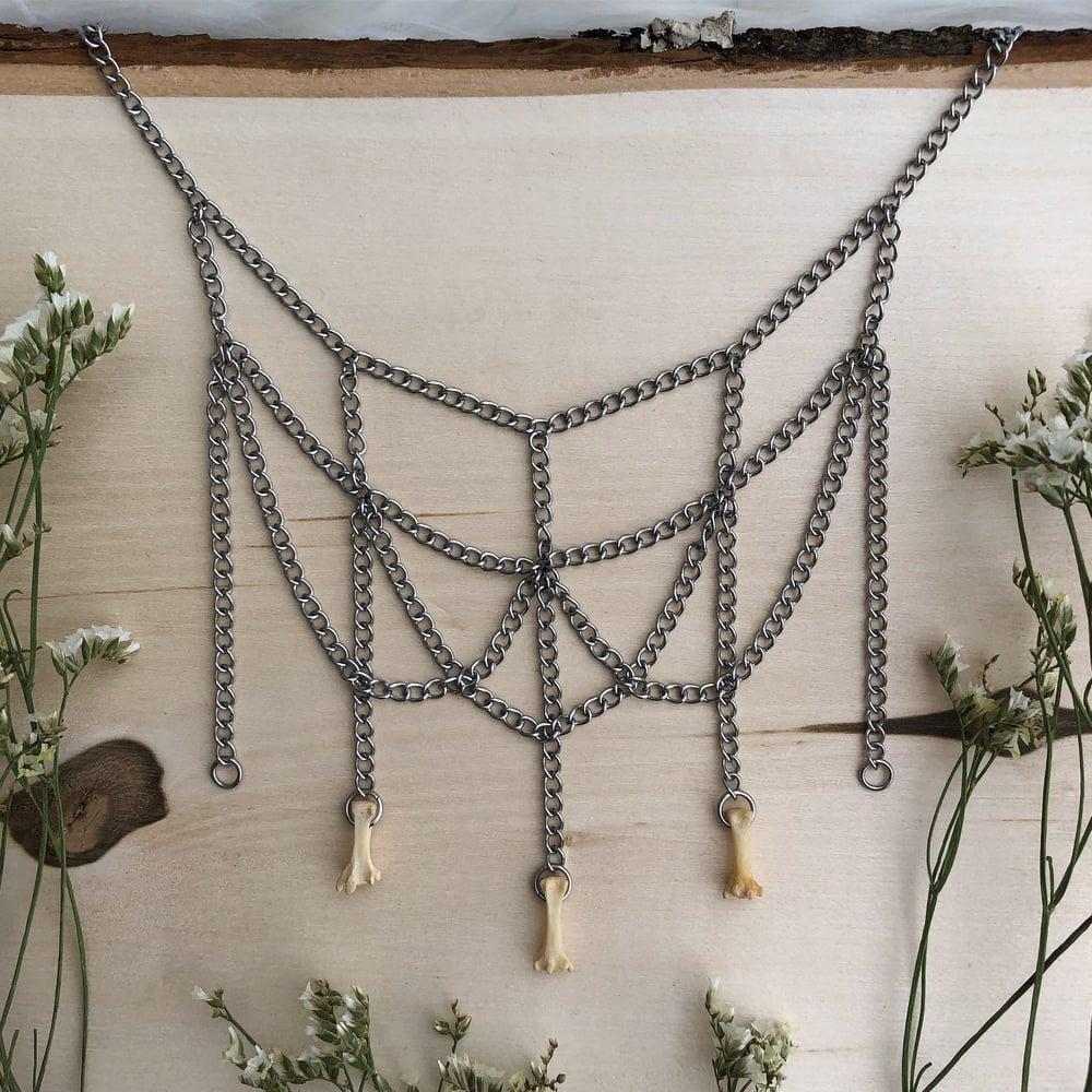 Image of triple raccoon vertebrae|chandelier choker