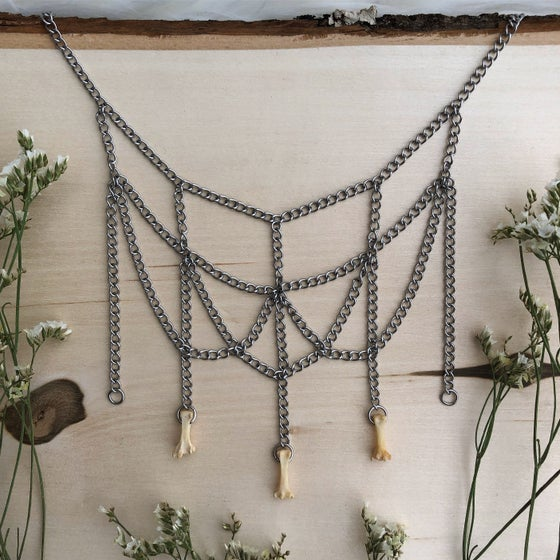 Image of triple raccoon vertebrae|chandelier choker