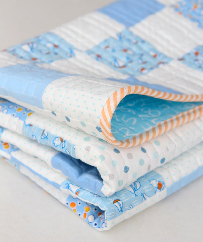 Image of Storybook Vacation Baby Quilt