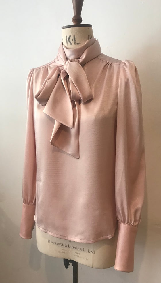 Image of Tie neck blouse with leather cuffs