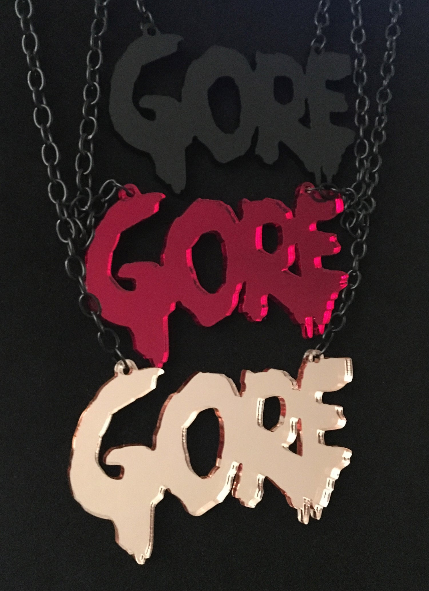 "Image of ""Gore"" Acrylic Necklaces/Car Mirror Charms"