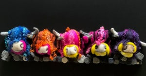 Image of Multicoloured Highland Cows