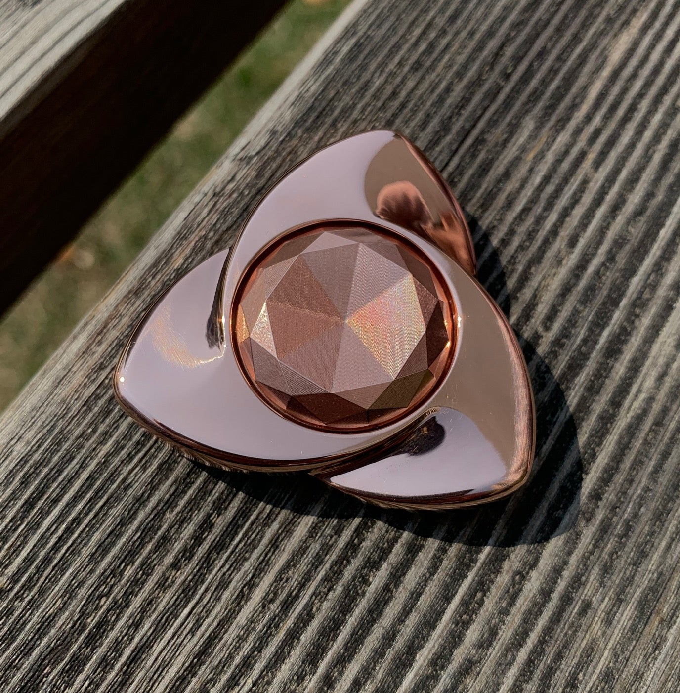 Image of Copper/SS/Ti /zirc  Rose XL polished hand spinner drop time  30th April 08:00pm EST