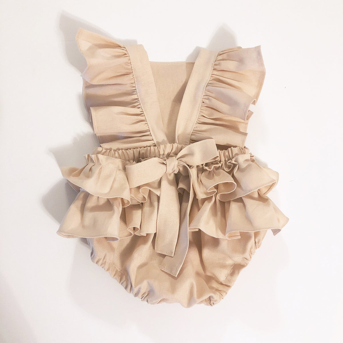 Image of Linen ruffle romper in peachy blush
