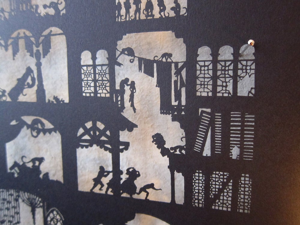 Image of Nylmah lasercut: pages seven and eight
