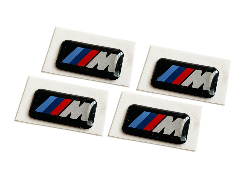 Image of M wheel emblems