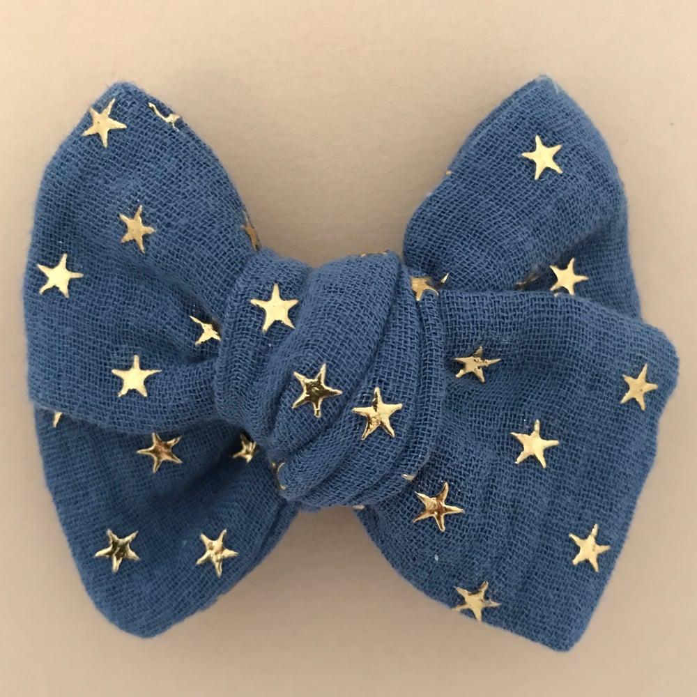 Image of Barrette double gaze bleue étoiles dorées