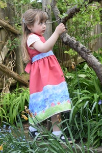 Image of Pinafore dress with agapanthus border print