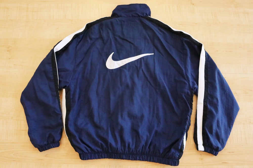 Image of Vintage 1990's Nike Air Swoosh Navy Windbreaker Jacket Sz.L