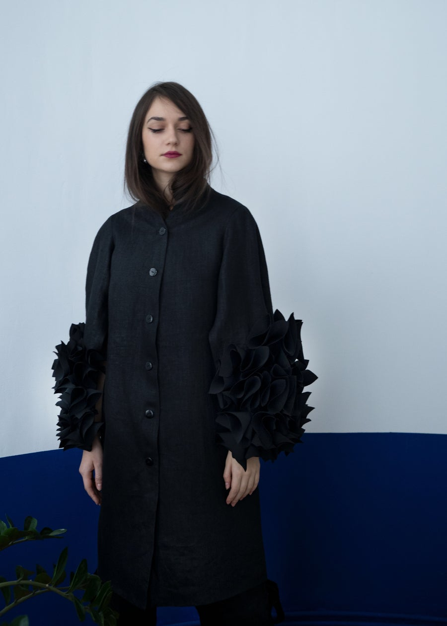 Image of Black coat with open flower-is sleeves