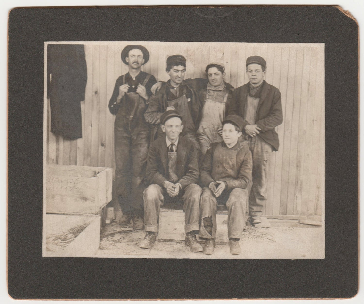 Image of Six workers posing with their denim overall, ca. 1903