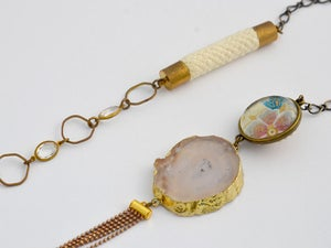 Image of Long asymmetrical crystal - rope - geode assemblage