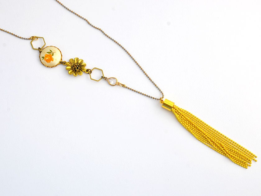 Image of yellow rose vintage assemblage  with yellow tassel