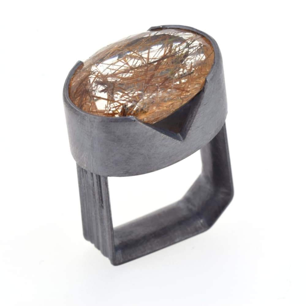 Image of Monolith ring, 17.5ct rutile quartz in a cutaway bezel setting in oxidised silver