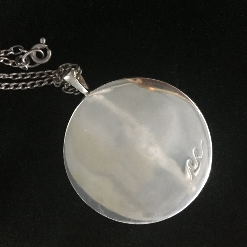 Image of Pendant Necklace inspired by water.