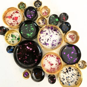 "Image of Colored Metal Flake Plugs (sizes 0g-2"")"