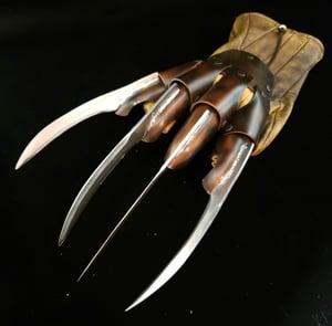 Image of Plastic VS glove
