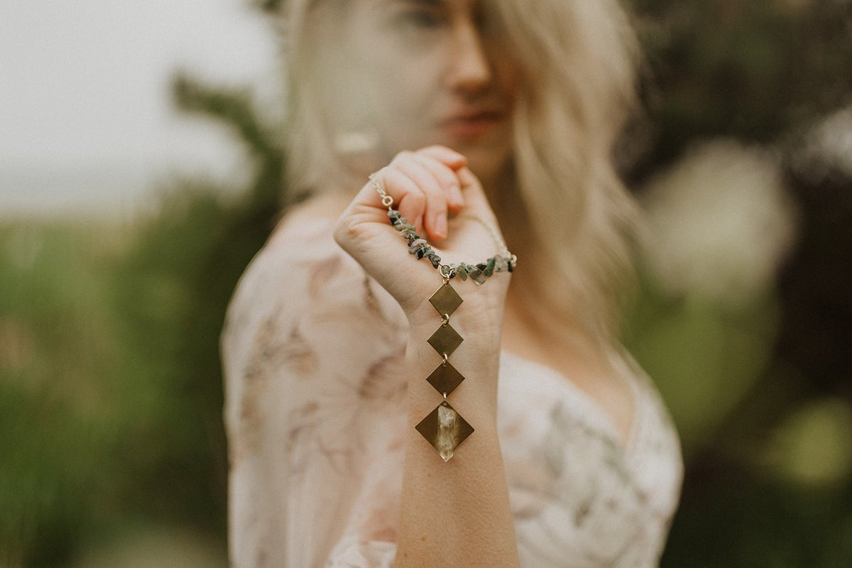 Image of stone + brass long drop necklace
