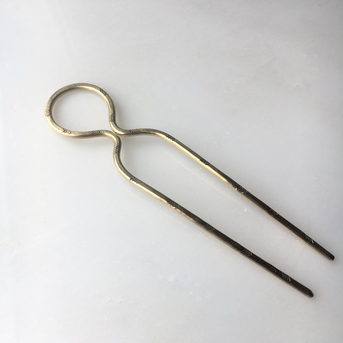 Image of stamped loop hair pin