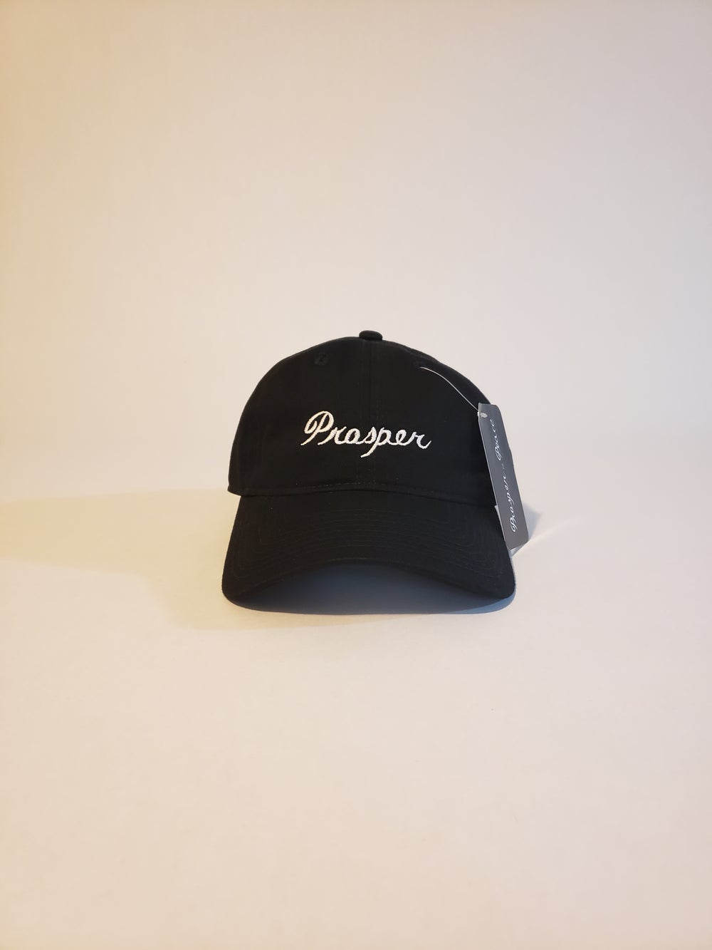 "Image of ""Prosper"" Strap back hat - black/white"