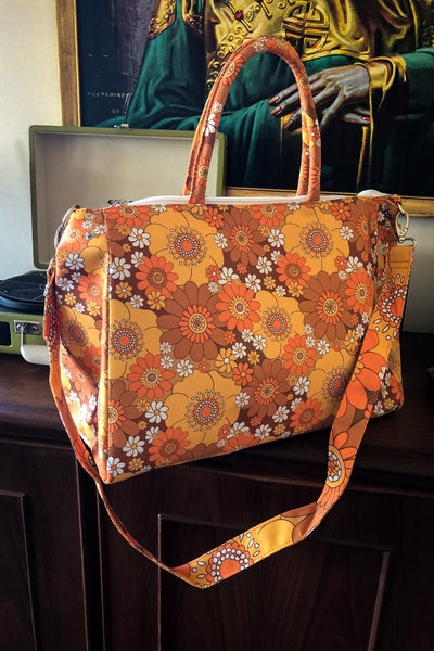 Image of Daytripper Overnight Bag in Pushing Daisies Brown and Orange