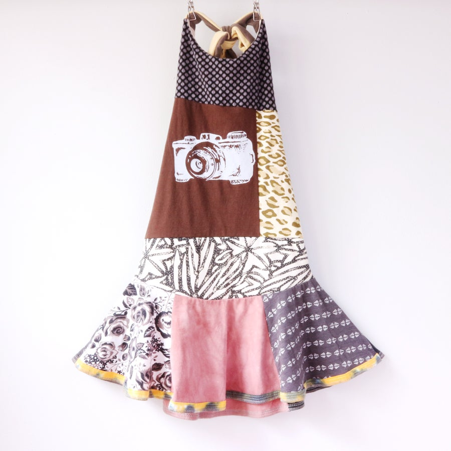 Image of WrenWillow camera 7/8 twirly earth animal print twirl halter dress
