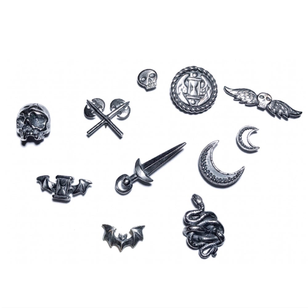 Image of Arcana Obscura lapel pins in oxidized sterling silver