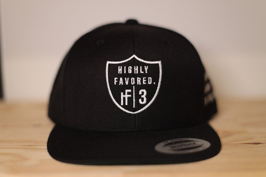 Image of Black Highly Favored Raiders SnapBack Baseball Cap
