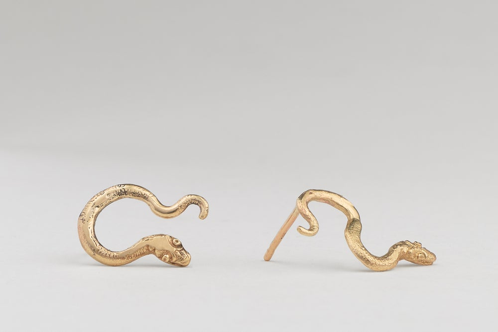Image of Gold serpent earrings