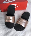 Image of Swarovski Nike KAWA Slides Black Sandals customized with Swarovski Crystals.