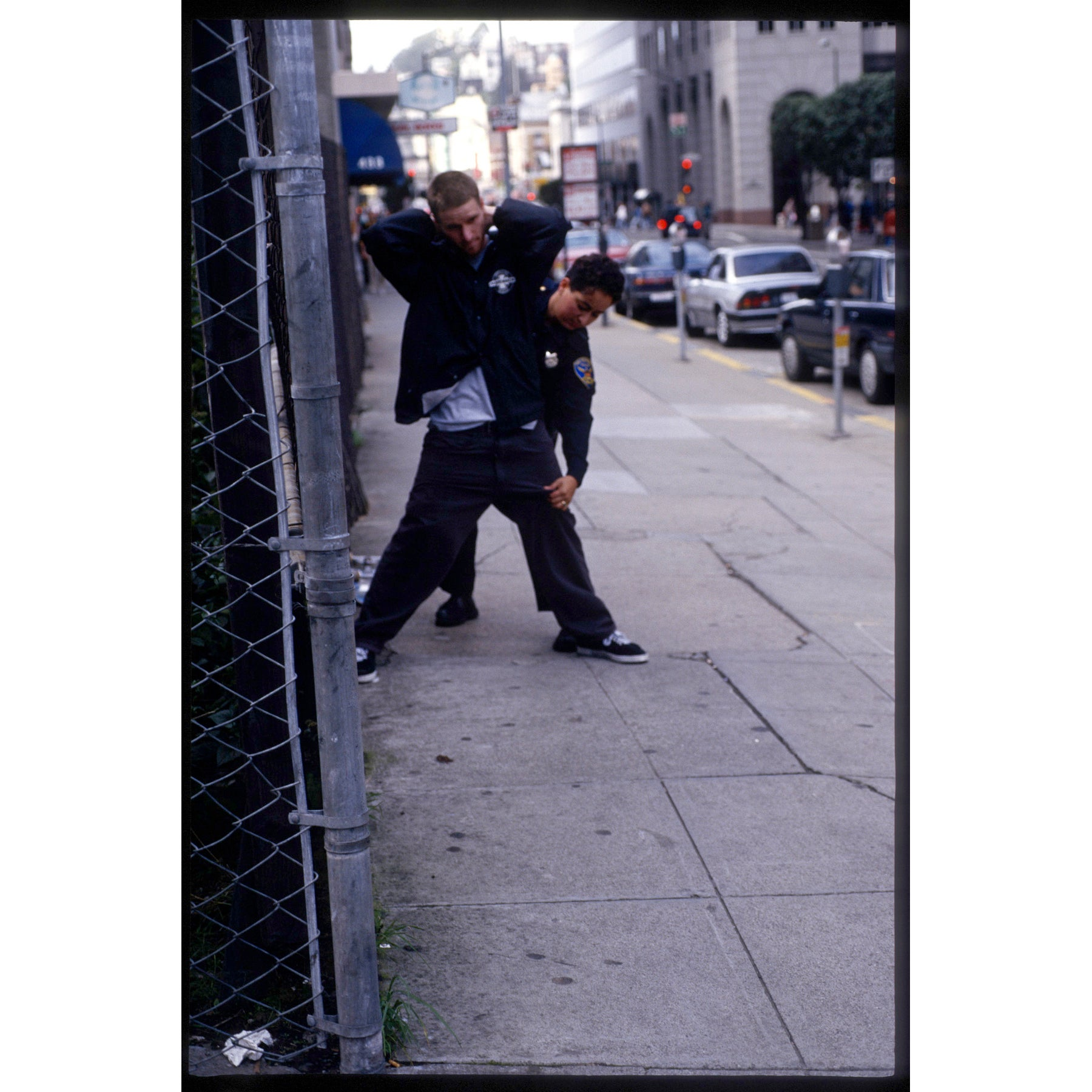 Image of Julien Stranger and SF cop 1995, by Tobin Yelland